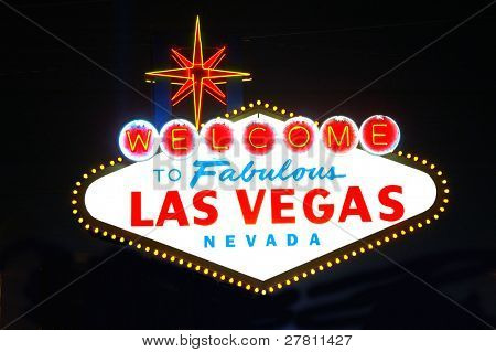 A night time view of the Welcome to Las Vegas sign