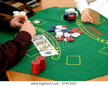 Office workers playing a friendly game of Strip Texas Hold 'um Poker in the office. Isolated over white