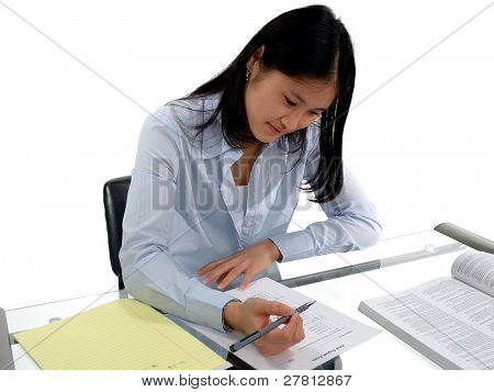 Female student intently concentrating on an English Exam