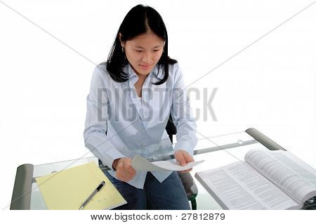 Female student proof reading an assignment