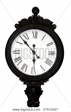 Antique street clock with roman numerals in an intricate cast iron casing Great crackle detail in paint on face at 100%