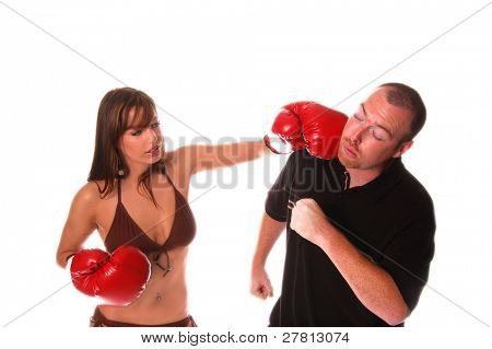Sexy redheaded bikini  model in boxing gloves knocks out a big guy  isolated over white