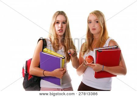 Two blond high school senior girls hanging out and holding text books and an apple