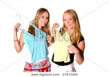 Pretty Young Blonde girls comparing blouses on a shopping trip. Isolated over white