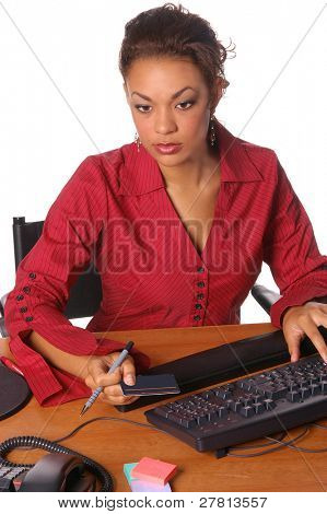 A corporate office worker making an on line purchase with a credit card.  Credit card is blank and ready for your info.