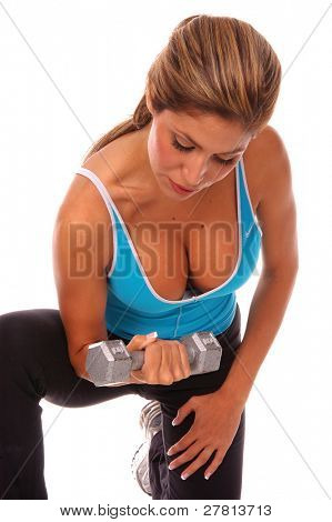 Sexy latino woman working out with free weights