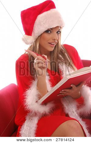 A very sexy Mrs. Santa Clause making a list are you on it?