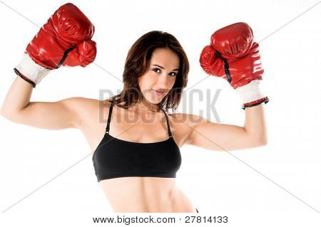 Sexy and well fit female boxer raises her gloves in victory