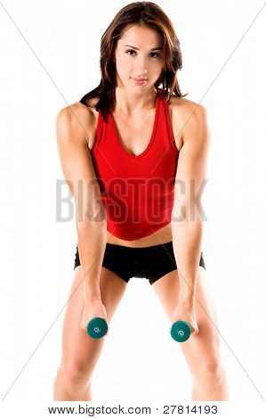 Fit and trim woman working out with dumbells