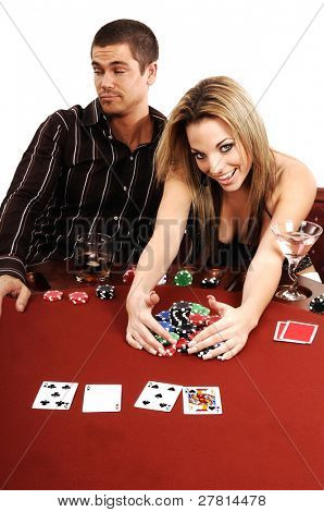 A sexy young blond winning the pot in a high stakes Texas Holdum Poker game Card backs are a digitally created design