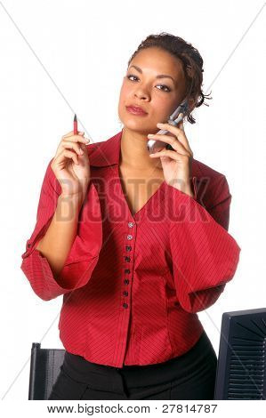 Beautiful woman in red pin stripe blouse and black slacks holding a pen and talking on a cell phone