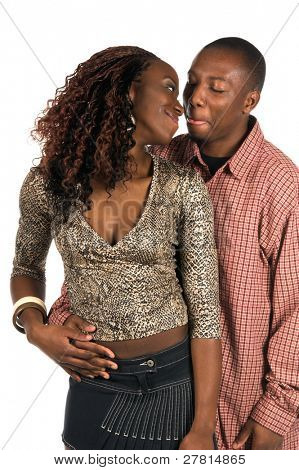 Sexy African American couple;  woman in a casual denim skirt and snake skin print top standing with her man