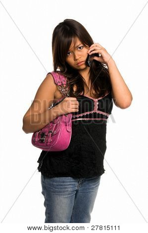 Beautiful young Asian woman talking on a cell phone