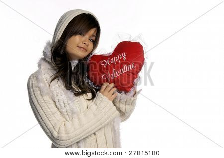 Beautiful  young Asian woman  in a heavy sweater and scarf holding up a red velvet and lace Valentine heart