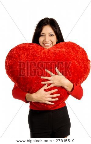 Beautiful latina woman with  a big red heart shape pillow