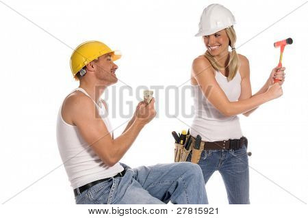 A female constructon worker coherses her male counterpart for money