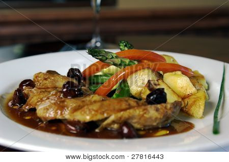 Roasted breast of Duck with cherries and grilled vegetables and potatoes