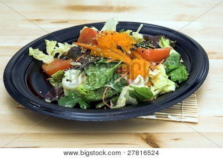 Asian salad greens with tomatoes, cucumber, carrot, lettuce, field greens and smelt roe