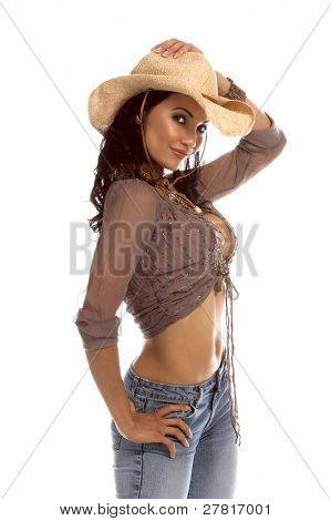 Super sexy rodeo cowgirl in torn jeans and a straw cowboy hat.