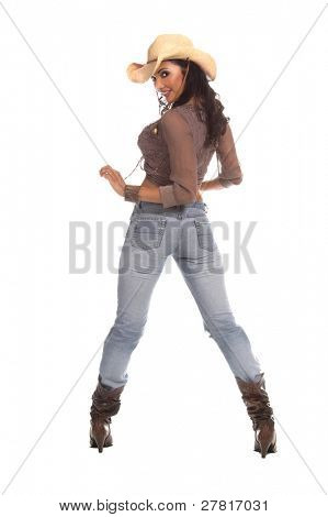 Super sexy rodeo cowgirl in torn jeans, boots and cowboy hat