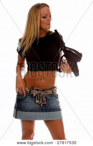 Beautiful blond woman in a clean black t-shirt ready for your logo or trademark. Holding a paintball marker