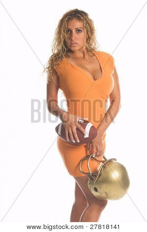 A beautiful Latina woman in a pumpkin spice orange knit dress with a football and helmet
