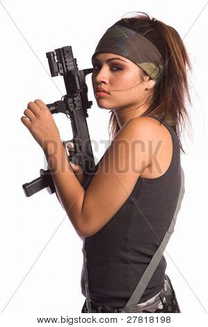 Beautiful young Latina Warrior Woman in military camo with an automatic assault weapon