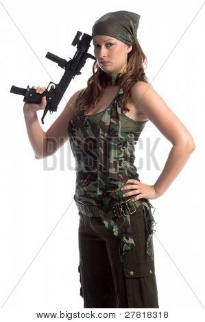 Woman dressed in green camo clothing and armed with an automatic hand gun
