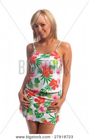 Sexy blond swim wear model in a white tankini with a large and bold pink and green Hibiscus flower print. Hands at sides slight tilt to shoulders