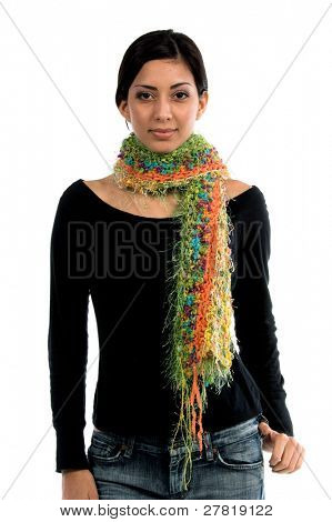 Left profile of a beautiful young Mexican woman in jeans and a black shirt and a courtier Angora wool shawl of yellow,red,orange and green yarn
