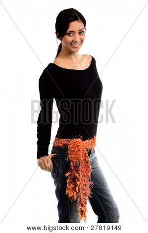 Right profile of a beautiful young Mexican woman in jeans and a black shirt and an orange couture feather wool belt