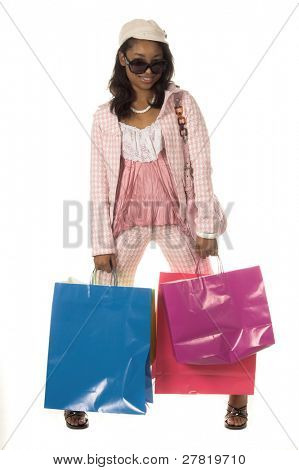 Full body view of a Beautiful young African American girl wearing super model sunglasses and a little hat and shopping it up like a true Hollywood Diva carrying an assortment of colorful shopping bags