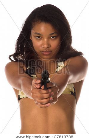 Beautiful young African American woman in a camo bikini points a 45 caliber handgun at the camera