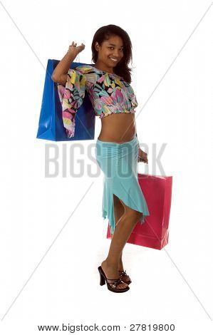 Full body view of a Beautiful young African American girl Holding colorful shopping bags