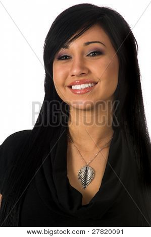 Close up beauty shot of a teenage girl with silky black hair and big green eyes wearing a silver leaf necklace