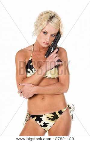 Sexy blond swim wear model in a camo bikini with a handgun