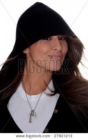 Tight head shot of a beautiful Latina with a lip ring and wearing a black hoodie