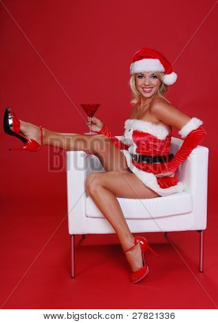 After a long days work Santa's sexy helper throws her feet up and relaxes with a Martini in a Christmas Red glass.