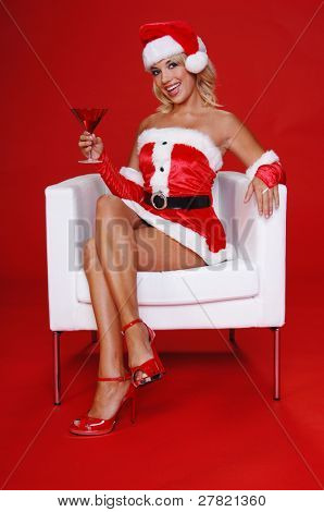 After a long days work Santa's sexy helper relaxes with a fresh Christmas Martini and a smile.