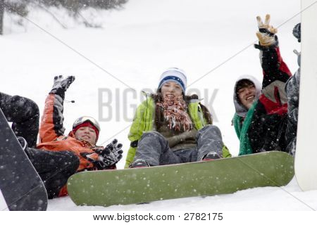 Group Of Sports Teenagers Snowborders In Mountains In Snow