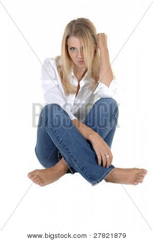 Casual head shot of a beautiful barefooted blonde in jeans and a white button down blouse