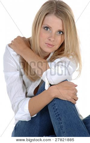 Casual head shot of a beautiful blonde in jeans and a white button down blouse