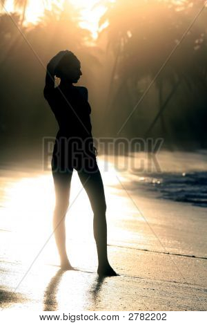 Woman Silhouette By Sunset