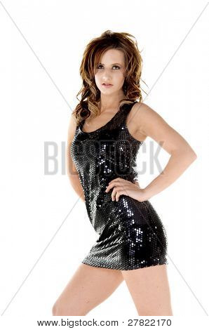 Sexy young glam rock woman in a black sequin mini dress