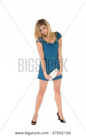 Casual young woman out for the day in a turquoise dress looking back over her shoulder