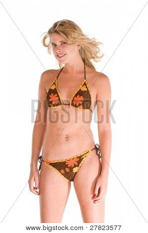 Young blond woman in a crotchet bikini and big furry winter platform boots