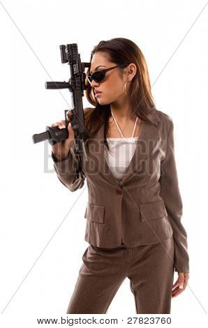 Young multi-ethnic woman in a business suit and dark sunglasses as an armed Secret Service Woman with a semi-automatic handgun
