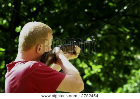 Young Man With A Hunting Rifle