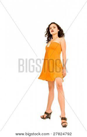 Beautiful multi ethnic woman of Spanish and Native American descent wearing an orange dress