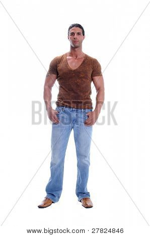 Muscular young man standing in jeans and a brown V neck tee shirt